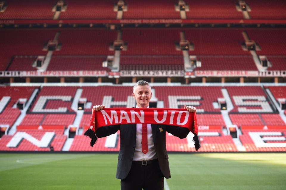 Picture of Ole Gunnar Solskjaer holding scarf at Old Trafford